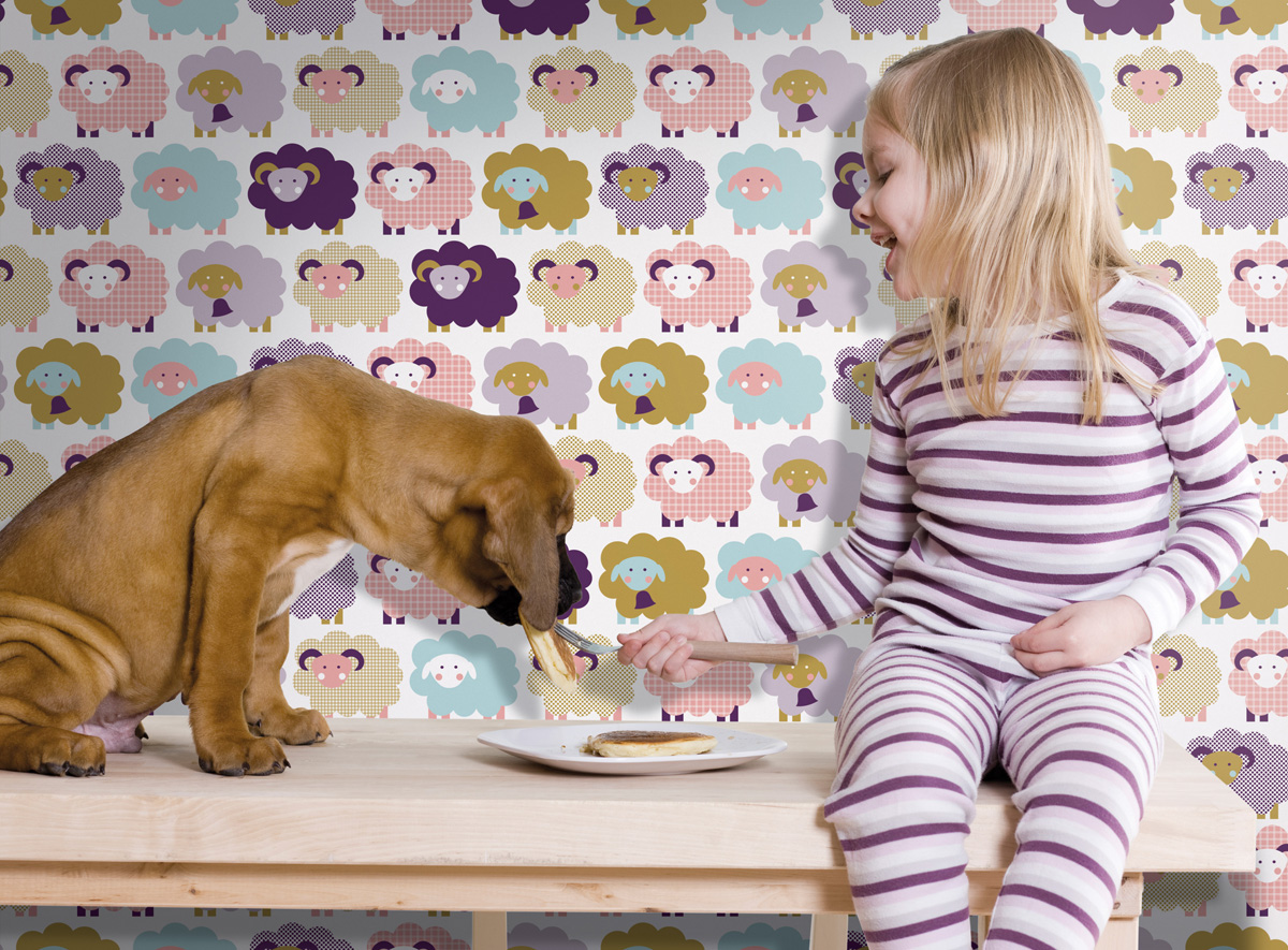 little girl feeding pancakes to her dog